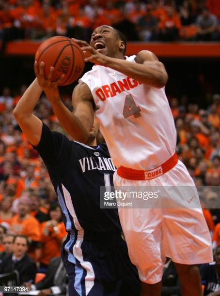 Wesley Johnson of the Syracuse Orange drives past Corey Fisher of the Villanova Wildcats during the game at the Carrier Dome on February 27 2010 in...