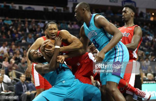 Wesley Johnson of the Washington Wizards battles for a loose ball against Michael KiddGilchrist of the Charlotte Hornets during their game at...