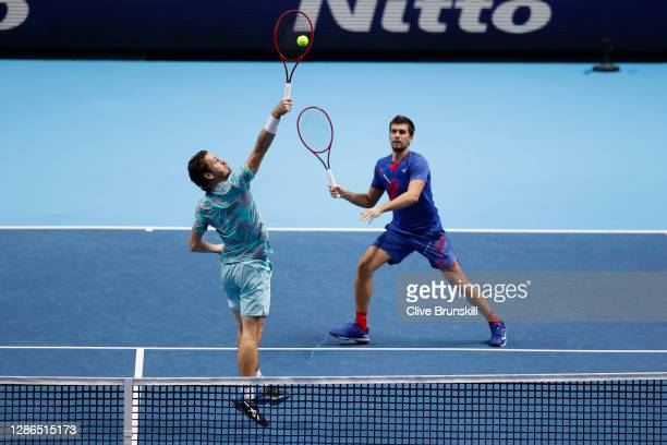 Wesley Koolhof of Netherlands and Nikola Mektic of Croatia in action during their Men's Doubles match against Lukasz Kubot of Poland and Marcelo Melo...