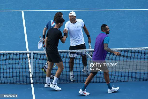Wesley Koolhof of the Netherlands and Lukasz Kubot of Poland celebrate winning their Men's Doubles second round match against Thanasi Kokkinakis and...