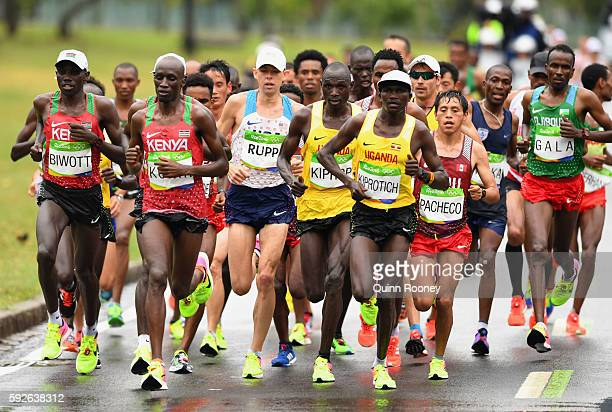 Wesley Korir of Kenya Galen Rupp of the United States Jackson Kiprop of Uganda and Stephen Kiprotich of Uganda compete during the Men's Marathon on...