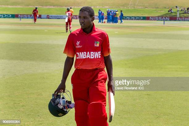 Wesley Madhavere of Zimbabwe walks back to the dressing room having been bowled out for 30 by Riyan Parag of India during the ICC U19 Cricket World...