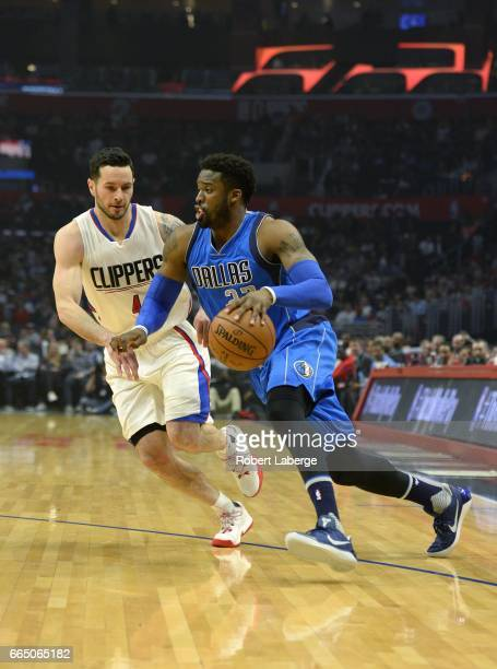 Wesley Matthews of the Dallas Mavericks dribbles the ball around JJ Redick of the Los Angeles Clippers on April 5 2017 at STAPLES Center in Los...