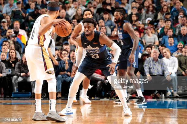 Wesley Matthews of the Dallas Mavericks guards against Tim Frazier of the New Orleans Pelicans on December 26 2018 at the American Airlines Center in...