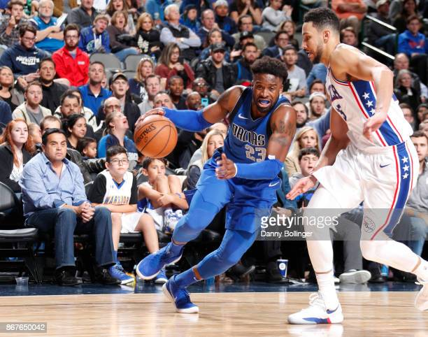 Wesley Matthews of the Dallas Mavericks handles the ball against Ben Simmons of the Philadelphia 76ers on October 28 2017 at the American Airlines...