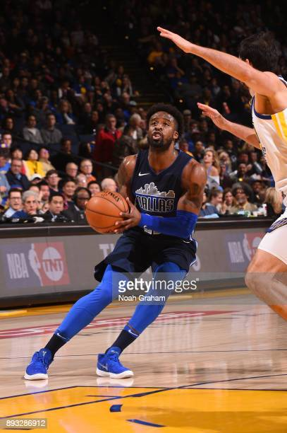 Wesley Matthews of the Dallas Mavericks handles the ball against the Golden State Warriors on December 14 2017 at ORACLE Arena in Oakland California...