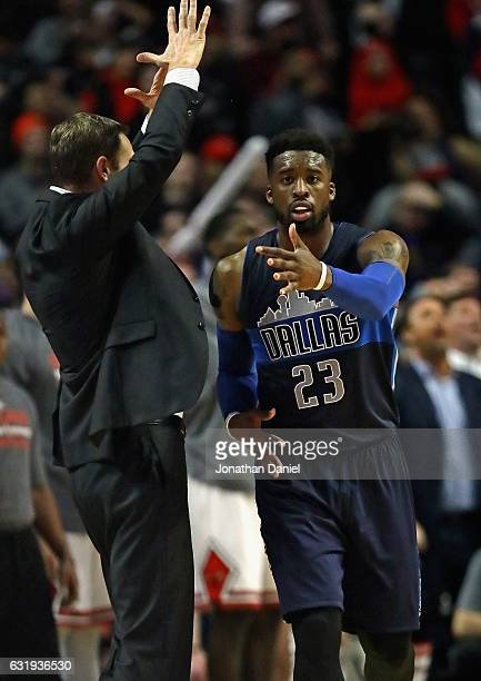 Wesley Matthews of the Dallas Mavericks reacts after hitting the gamewinning shot as head coach Fred Hoiberg of the Chicago Bulls calls time out at...