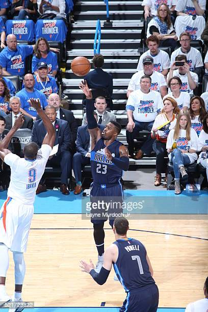 Wesley Matthews of the Dallas Mavericks shoots against Serge Ibaka of the Oklahoma City Thunder in Game One of the Western Conference Quarterfinals...