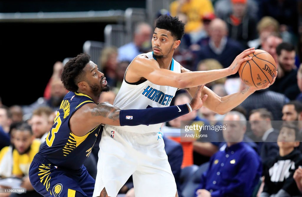 Wesley Matthews of the Indiana Pacers defends Jeremy Lamb of