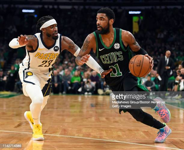 Wesley Matthews of the Indiana Pacers left defends against Kyrie Irving of the Boston Celtics during the second half in Game 1 of a firstround NBA...