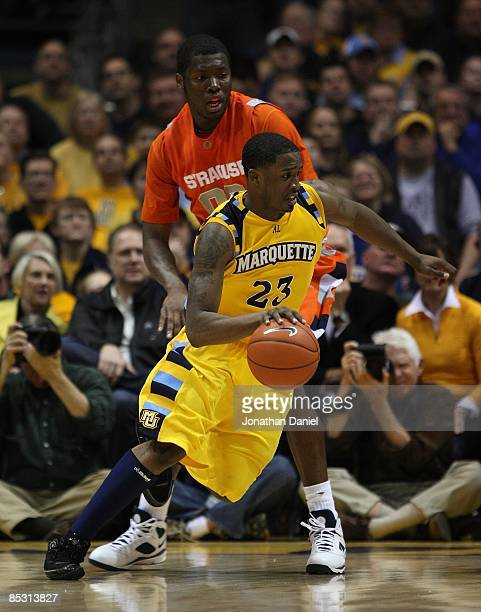 Wesley Matthews of the Marquette Golden Eagles drives around Rick Jackson of the Syracuse Orange on March 7 2009 at the Bradley Center in Milwaukee...