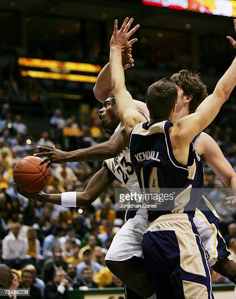 Wesley Matthews of the Marquette Golden Eagles puts up a shot between Levon Kendall and Aaron Gray of the Pittsburgh Panthers on March 3 2007 at the...