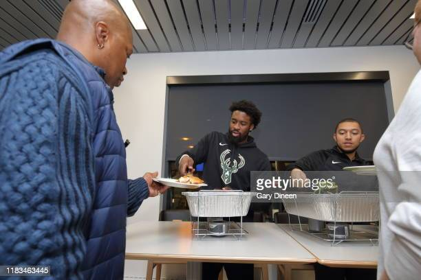 Wesley Matthews of the Milwaukee Bucks and former Bucks player and FOX Sports Wisconsin analyst Steve Novak host a dinner for veterans from the...