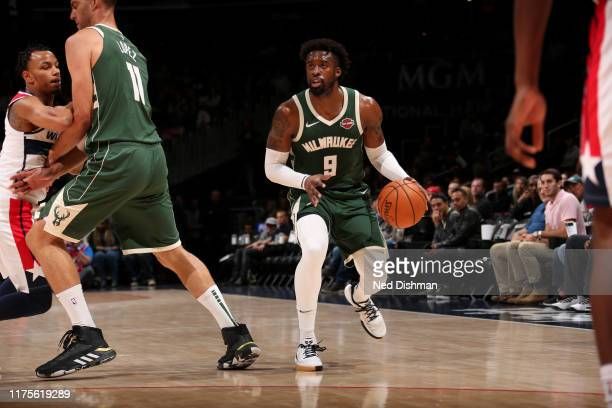 Wesley Matthews of the Milwaukee Bucks handles the ball against the Washington Wizards during a preseason game on October 13 2019 at Capital One...