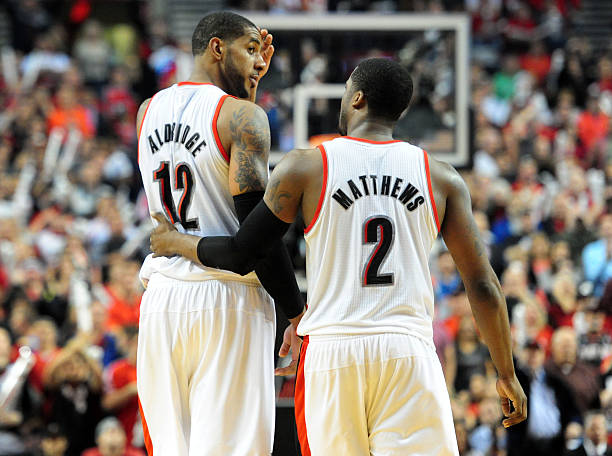 Wesley Matthews, of the Trail Blazers, calms down LaMarcus...