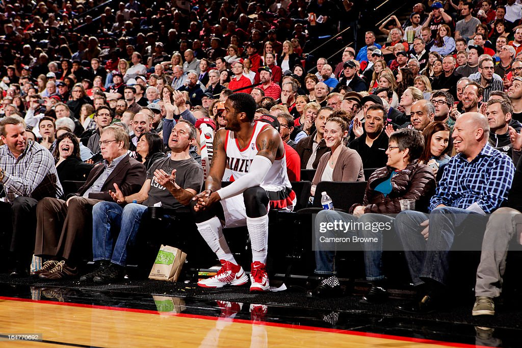 Wesley Matthews #2 of the Portland Trail Blazers shares a laugh with fans after falling into the stands during a game against the Memphis Grizzlies on March 12, 2013 at the Rose Garden Arena in Portland, Oregon.