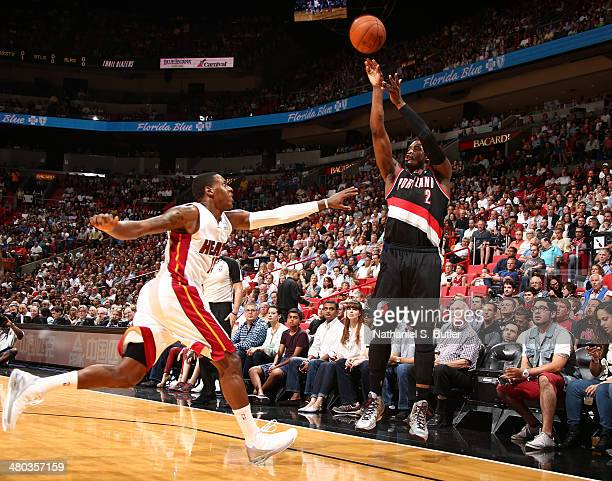 Wesley Matthews of the Portland Trail Blazers shoots against Mario Chalmers of the Miami Heat on May 24 2013 at American Airlines Arena in Miami...