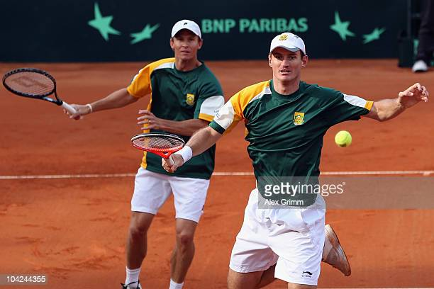 Wesley Moodie and Rik de Voest of South Africa play against Christopher Kas and Andreas Beck of Germany during their double match at the Davis Cup...