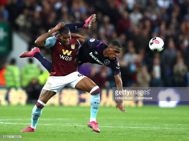 Wesley Moraes of Aston Villa and Sebastien Haller of West Ham United collide during the Premier League match between Aston Villa and West Ham United...