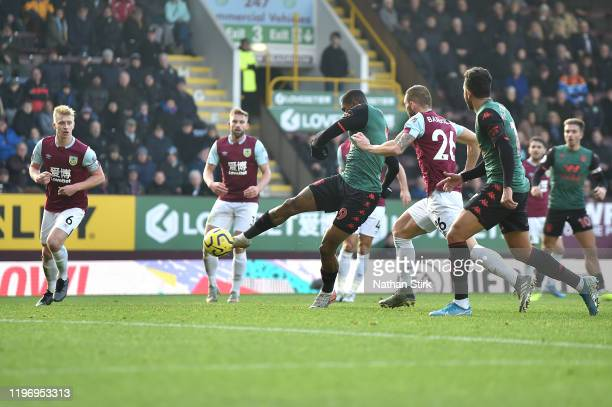 Wesley of Aston Villa scores his sides first goal during the Premier League match between Burnley FC and Aston Villa at Turf Moor on January 01 2020...