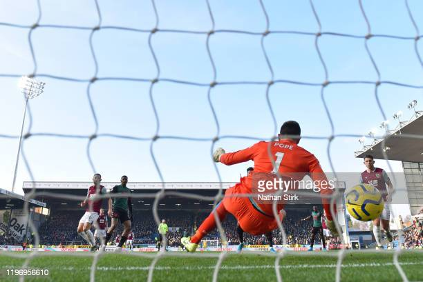 Wesley of Aston Villa scores his sides first goal past Nick Pope of Burnley during the Premier League match between Burnley FC and Aston Villa at...