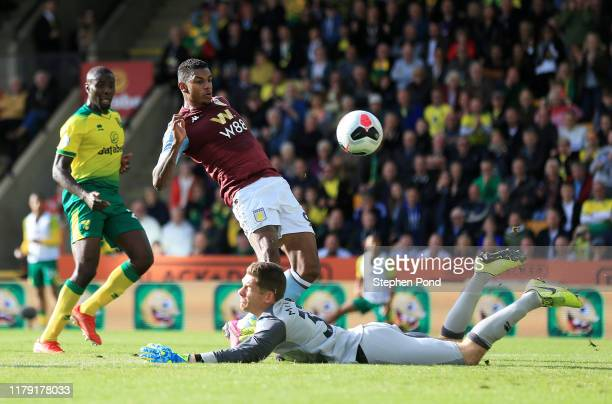 Wesley of Aston Villa shoots as Michael McGovern of Norwich City attempts to save during the Premier League match between Norwich City and Aston...