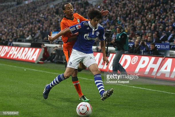 Wesley of Bremen challenges Atsuto Uchida of Schalke during the Bundesliga match between FC Schalke 04 and SV Werder Bremen at Veltins Arena on...