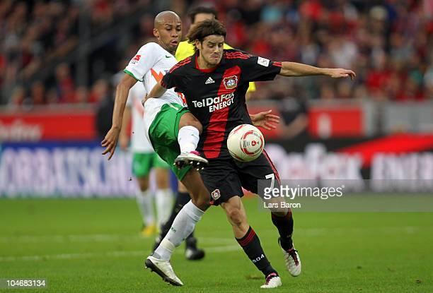 Wesley of Bremen challenges Tranquillo Barnetta of Leverkusen during the Bundesliga match between Bayer Leverkusen and Werder Bremen at BayArena on...