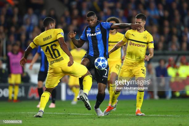 Wesley of Club Brugge battles for possession with Manuel Akanji of Borussia Dortmund during the Group A match of the UEFA Champions League between...