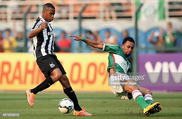 Wesley of Palmeiras fights for the ball with Robinho of Santos during the match between Palmeiras and Santos for the Brazilian Series A 2014 at...