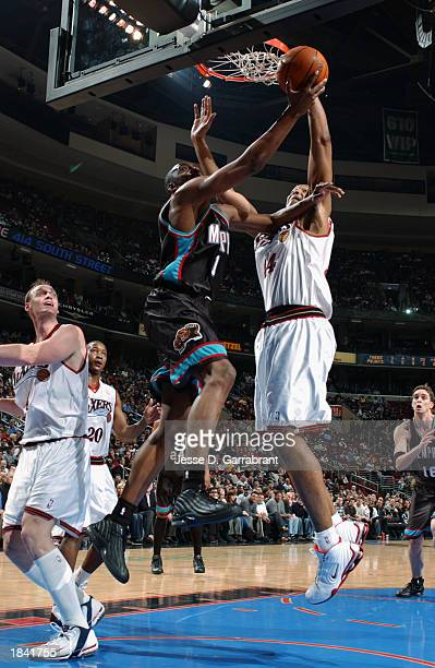 Wesley Person of the Memphis Grizzlies goes up for a layup against Derrick Coleman of the Philadelphia 76ers during the NBA game at first Union...