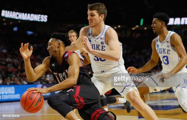 Wesley Person of the Troy Trojans drives against Antonio Vrankovic of the Duke Blue Devils in the first half during the first round of the 2017 NCAA...