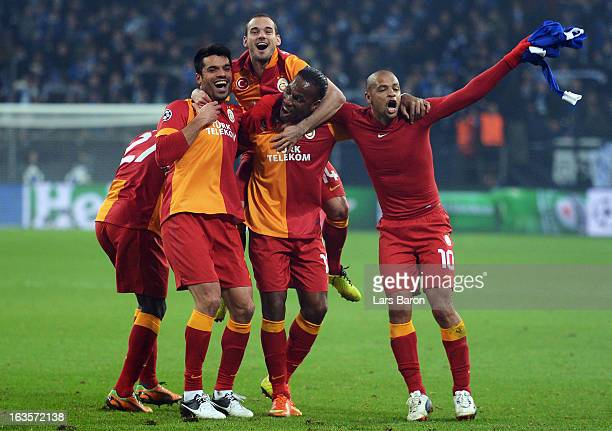 Wesley Sneijder and Didier Drogba of Galatasaray celebrate with team mates Goekhan Zan and Felipe Melo after winning the UEFA Champions League round...