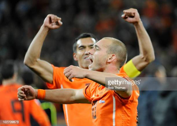 Wesley Sneijder and Giovanni Van Bronckhorst of the Netherlands celebrate victory and progress to the final after the 2010 FIFA World Cup South...
