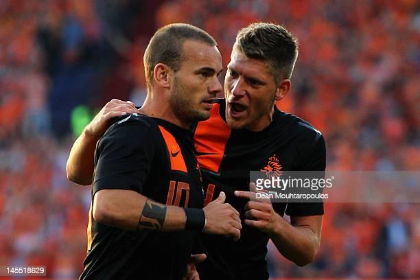 Wesley Sneijder and Stijn Schaars of Netherlands speak during the International Friendly between the Netherlands and Slovakia at De Kuip Stadion on...