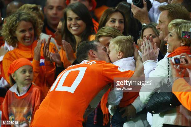Wesley Sneijder celebrates with his family after winning the UEFA EURO 2008 Group C match between Netherlands and France at Stade de Suisse Wankdorf...