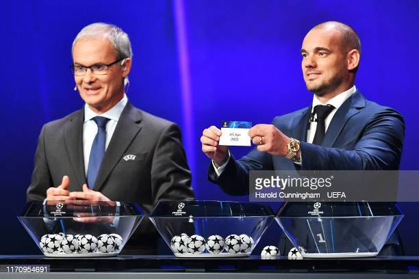 Wesley Sneijder draws out the name of AFC Ajax during the UEFA Champions League Draw, part of the UEFA European Club Football Season Kick-Off...
