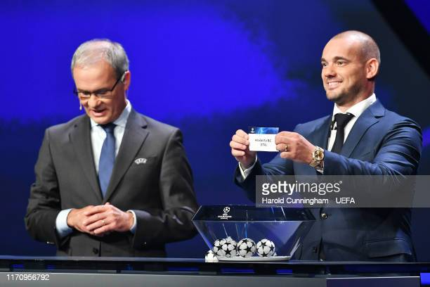 Wesley Sneijder draws out the name of Atalanta BC during the UEFA Champions League Draw, part of the UEFA European Club Football Season Kick-Off...
