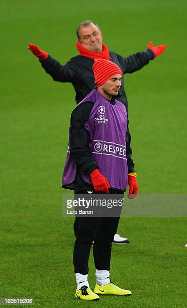 Wesley Sneijder is seen next to head coach Fatih Terim during a Galatasaray AS training session ahead of their UEFA Champions League round of 16...