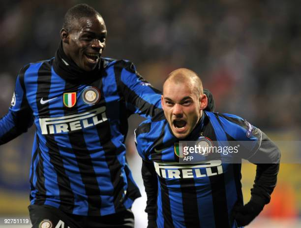 Wesley Sneijder of FC Inter Milan and Mario Balotelli react after scoring against FC Dynamo Kiev during UEFA Champions League Group F football match...