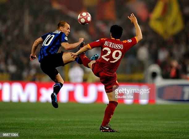 Wesley Sneijder of FC Inter Milan is injured during a tackle by Nicolas Burdisso of AS Roma during the Tim Cup final between FC Internazionale Milano...
