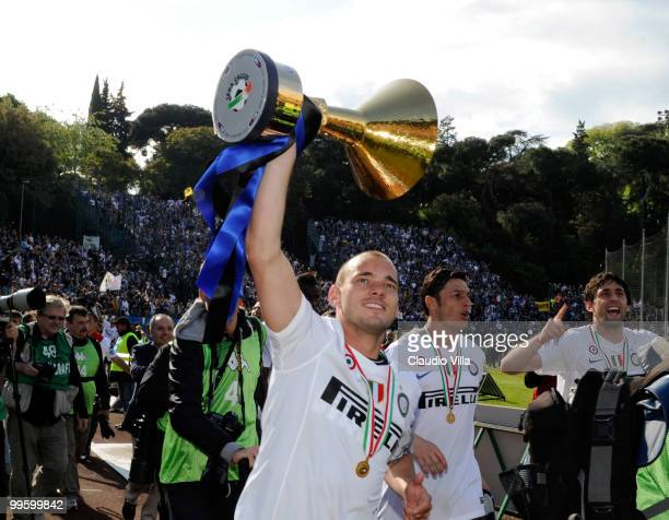 Wesley Sneijder of FC Internazionale Milano celebrates with the League trophy after the Serie A match between AC Siena and FC Internazionale Milano...