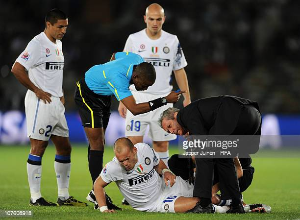 Wesley Sneijder of FC Internazionale Milano grimaces as he is being treated for injury shortly before abandoning the game during the FIFA Club World...