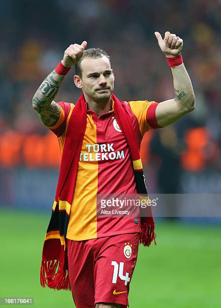 Wesley Sneijder of Galatasaray AS applauds their supporters after the UEFA Champions League Quarter Final match between Galatasaray AS and Real...