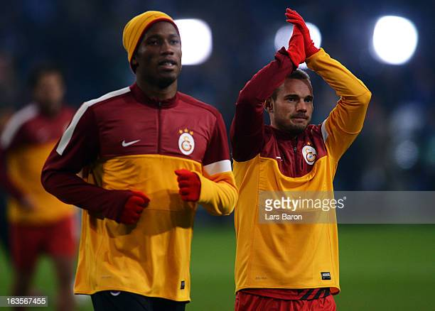 Wesley Sneijder of Galatasaray is seen next to Didier Drogba prior to the UEFA Champions League round of 16 second leg match between FC Schalke 04...