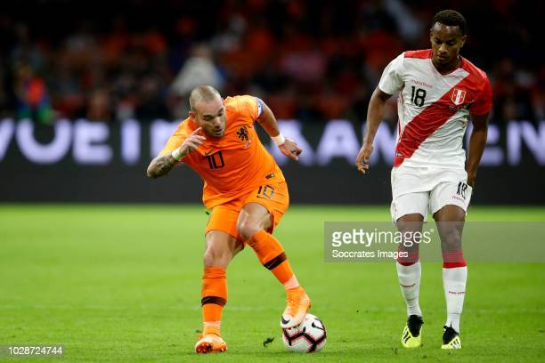 Wesley Sneijder of Holland Andre Carrillo of Peru during the International Friendly match between Holland v Peru at the Johan Cruijff Arena on...