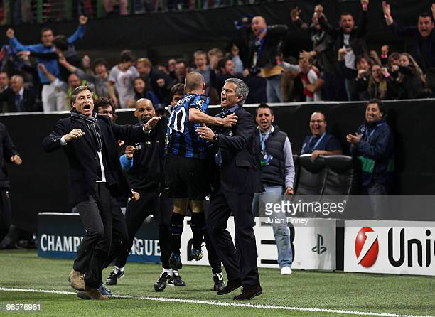 Wesley Sneijder of Inter celebrates his team's third goal scored by Diego Milito with manager Jose Mourinho during the UEFA Champions League Semi...