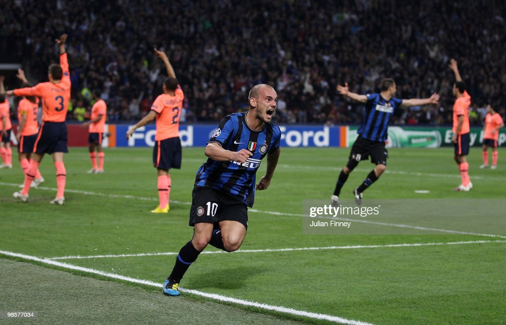 Wesley Sneijder of Inter celebrates his team's third goal, scored by Diego Milito, during the UEFA Champions League Semi Final 1st Leg match between Inter Milan and Barcelona at the San Siro on April 20, 2010 in Milan, Italy.