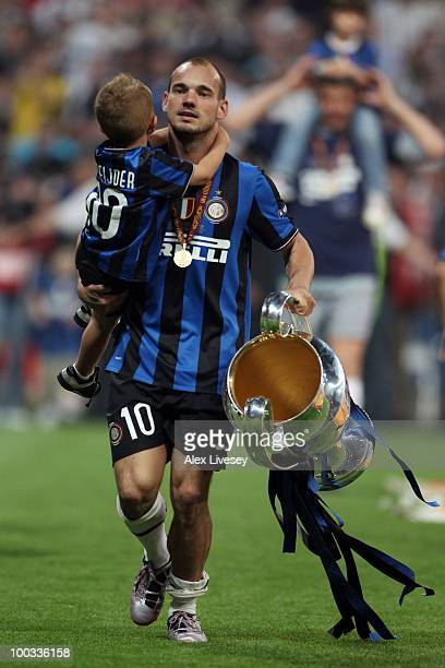 Wesley Sneijder of Inter Milan and his son celebrate with the UEFA Champions League trophy at the end of the UEFA Champions League Final match...
