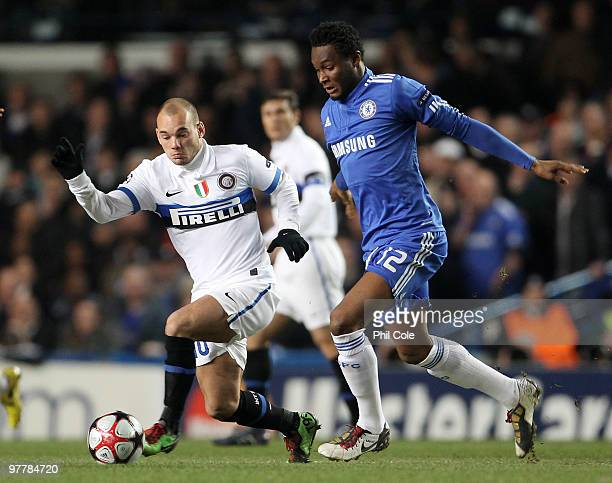 Wesley Sneijder of Inter Milan challenges for the ball with John Mikel Obi of Chelsea during the UEFA Champions League Round of 16 second leg match...